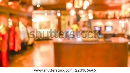 blurred image of shopping mall and people . - stock photo