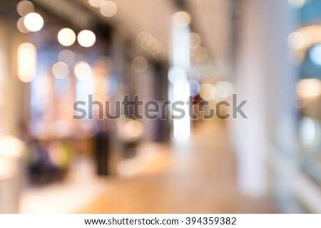 Blurred image of shopping mall and people - stock photo