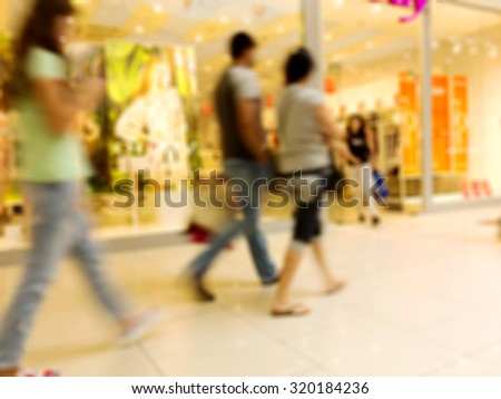 blurred image of shopping mall and people, bokeh for background usage. - stock photo