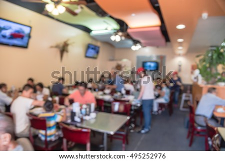 Blurred image of small and crowd Pho restaurant in Houston, Texas, US. Pho (Vietnamese noodle soup with broth, rice noodles, herbs, beef or chicken) is popular food in Vietnam and around the world.