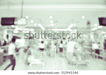 blurred image of supermarket - cashier counter customers - stock photo