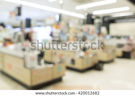 Blurred image of suppermarket cashier for background uses. - stock photo