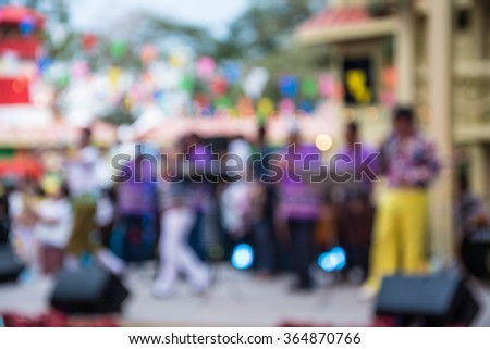 Blurred image of thai tradition folk song musicians performing on stage in Bangkok ,Thailand  - stock photo