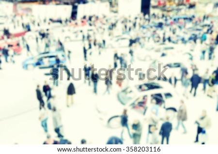 Blurred image of the International Geneva car show - stock photo