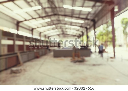 blurred image of warehouse underconstruction - stock photo