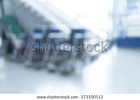 Blurred image of wheelchair seat row in hospital for background uses