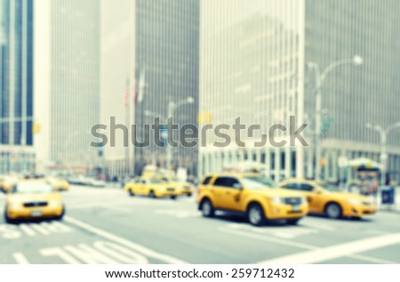 Blurred image of yellow taxis in the streets of Manhattan, New York City, USA  - stock photo