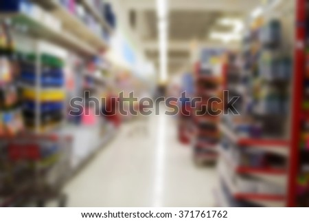 blurred image Supermarket store on background with bokeh - stock photo