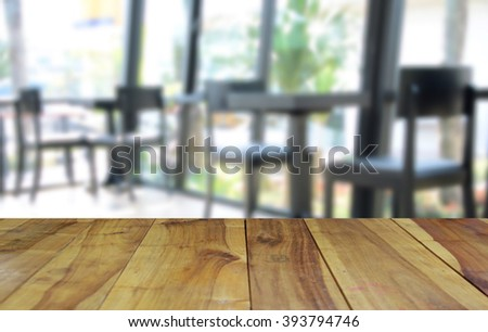 blurred image wood table and abstract visitor's chair in office - stock photo