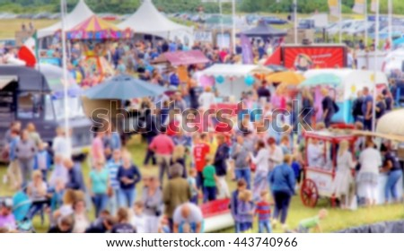 blurred images from a crowd of people at a outdoor summer festival