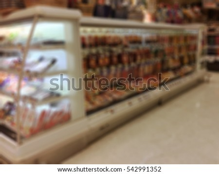 Blurred Interior of Food Section in Supermarket