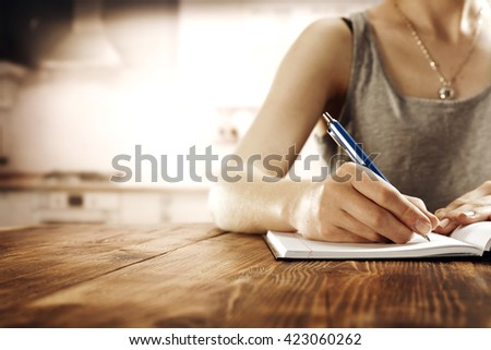 blurred interior of retro kitchen and blue pen and free space for your food  - stock photo
