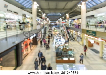 Blurred interior of shopping mall. - stock photo