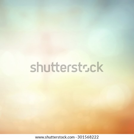 Blurred Jesus on the cross with crown of thorns over beautiful bokeh sunset or sunrise background. Forgiveness, Mercy, Humble, Repentance, christmas, Glorify, Catholicism, Redemption, Redeemer concept - stock photo