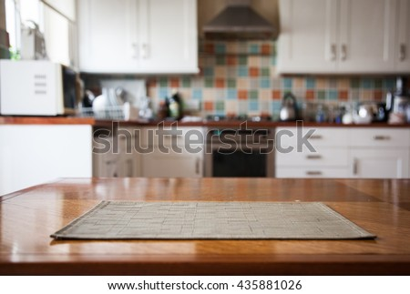 Blurred kitchen interior and napkin and desk space - stock photo