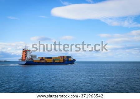 Blurred Large cargo ship sailing on the sea - stock photo
