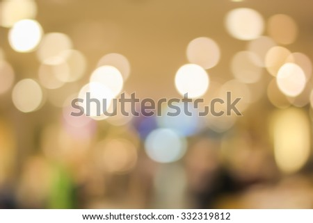 blurred light in warm tone backgrounds:blur of department store shopping concept: out of focus concept:blur of bokeh circle light christmas festive backdrop concept.golden hours conceptual. - stock photo