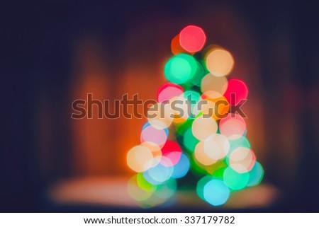 Blurred light on christmas tree, Bokeh of christmas tree - stock photo