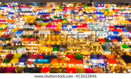 Blurred lights aerial view free market roof top, abstract background - stock photo