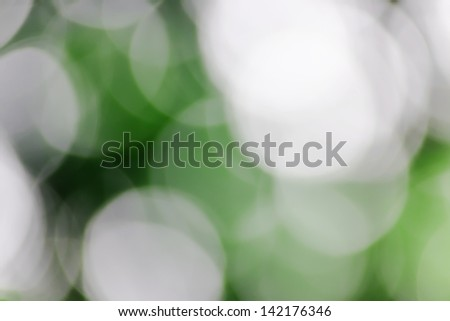 Blurred lights green bokeh abstract light background - stock photo