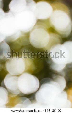 Blurred lights yellow bokeh abstract light background - stock photo