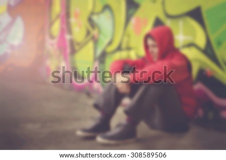Blurred lonely person on street abstract background. - stock photo