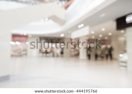 Blurred mall background. Bokeh effect. Concept of shopping, office, cafe, restaurant, city center. Holiday in mall. Defocused perspective. - stock photo