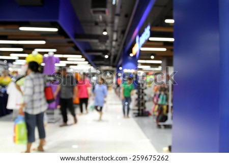 blurred man and women shopping at supermarket/mall  for background  - stock photo