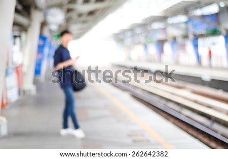 Blurred man waiting for subway at station, transportation background - stock photo