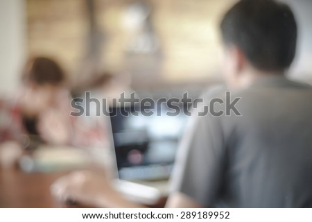 Blurred man with laptop at cafe background, business , technology concept - stock photo