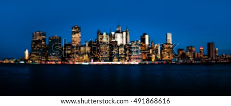 Blurred Manhattan. Early morning New York City downtown skyline out of focus bokeh panorama