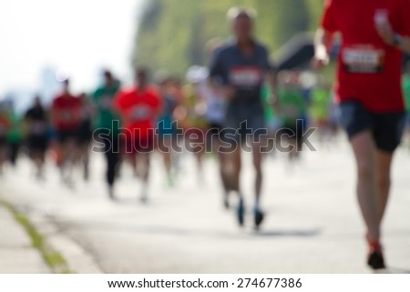 Blurred mass of marathon runners - stock photo