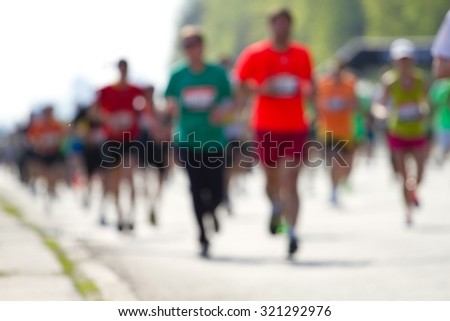 Blurred mass people of marathon runners