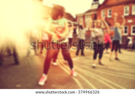 Blurred Modern dancers dancing on the street. Urban lifestyle. Hip-hop generation. - stock photo