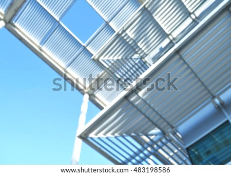 Blurred modern metal structure, roof of a building backdrop, blur architectural and civil-engineering construction concept