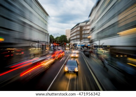 Blurred motion of cars on road in London city