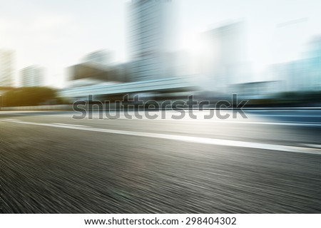 Blurred motion of modern skyline and urban street