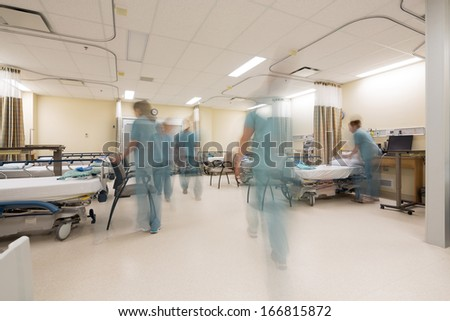 Blurred motion of nurses working in PACU unit