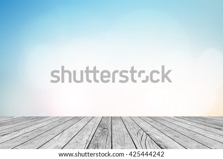 blurred natural blue sky gradient backdrop wall with old white wood colored background texture tabletop:rustic aged tiles wooden with blur pastel cool wallpaper.advertise,show your products on display - stock photo