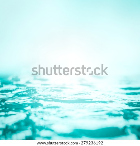 Blurred nature background of wavy water surface in cyan blue color tone  - stock photo
