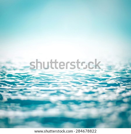 Blurred nature background of wavy water surface in cyan blue color tone with vignette : Healthy oceans, healthy planet concept - stock photo