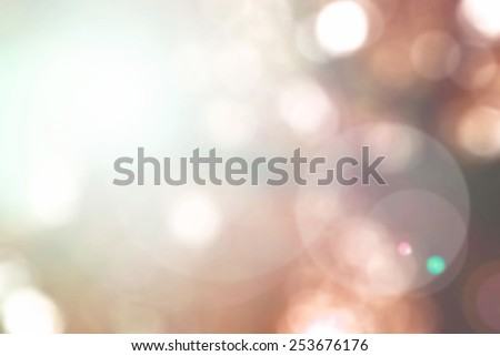 Blurred nature background with sun flare and bokeh of  tree looking upward in orange red tone in autumn season concept: Vintage color tone blurry view of autumn seasonal festival concept  - stock photo