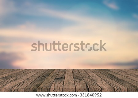 blurred nature sunset sky backdrop wall with old vintage grungy beige brown wood line backgrounds textures tabletop:rustic aged tiles wooden with blur backdrop.put,show your products on this display