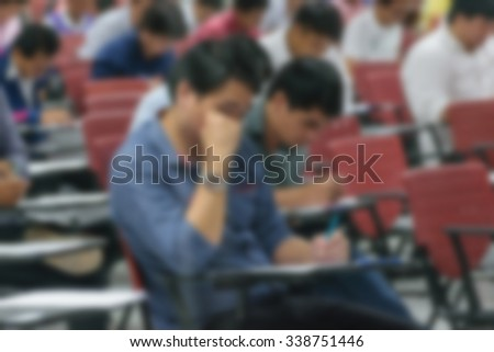 Blurred of Adults take exam for appoint at State Railway of Thailand.