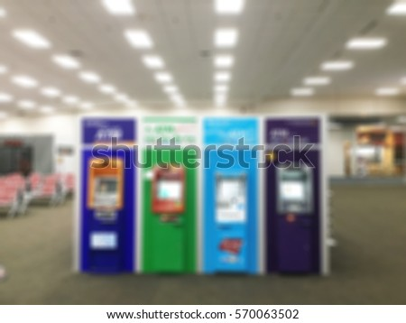 Blurred of ATM machine in airport for background usage