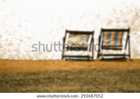 Blurred of Beach chair on sand beach - stock photo