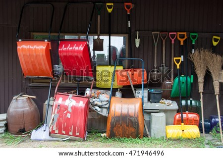 blurred of colorful gardening tools hanging on the wall
