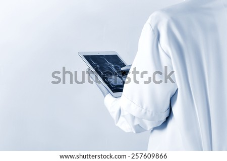 Blurred of Doctor working radiographs on a digital tablet - stock photo