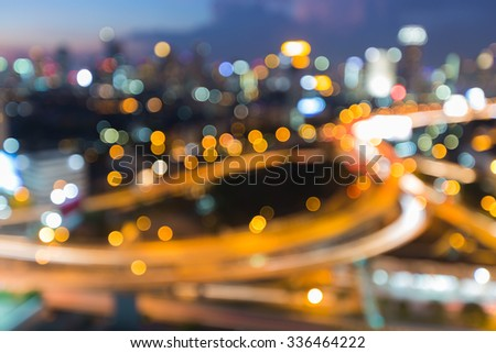Blurred of highway interchanged with city lights background - stock photo