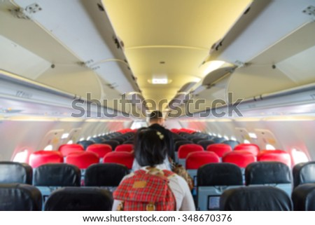 Blurred of interior aircraft with passengers, airplane cabins blur.